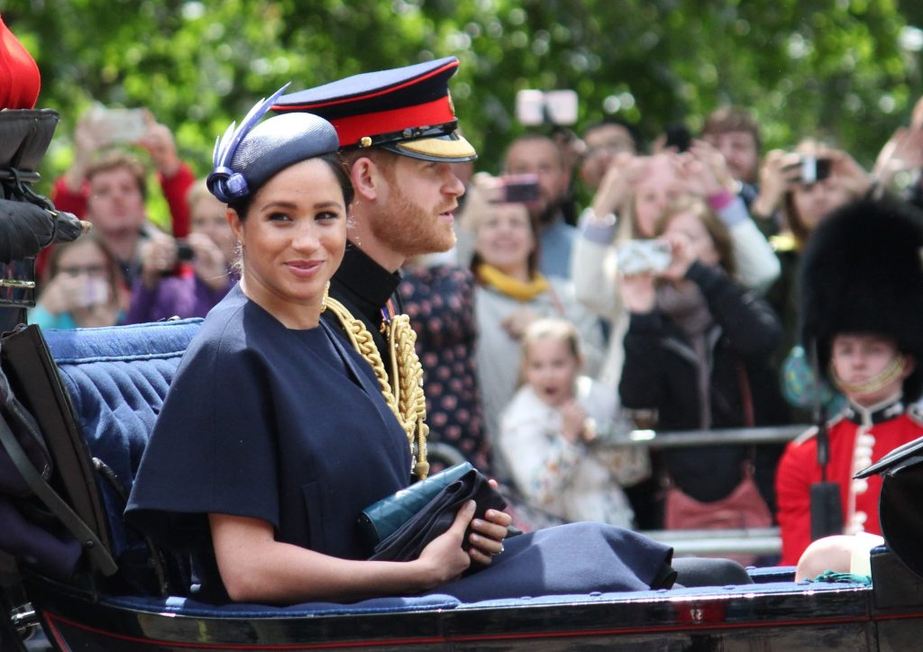 Meghan Markle rides in a carriage in London with her husband Prince Harry