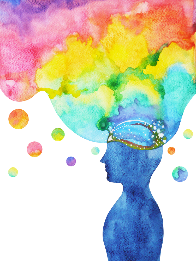 Coloring your characters. This abstract image features a silhouetted man with a rainbow-colored cloud coming out of his head.