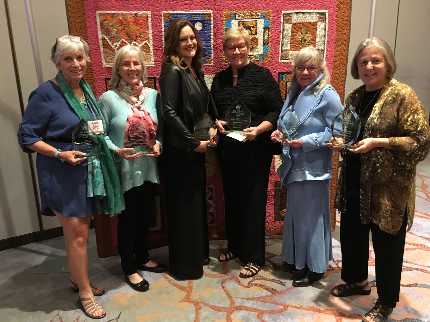 A group of WILLA Literary Award-winning authors gather at a past Women Writing the West Conference.