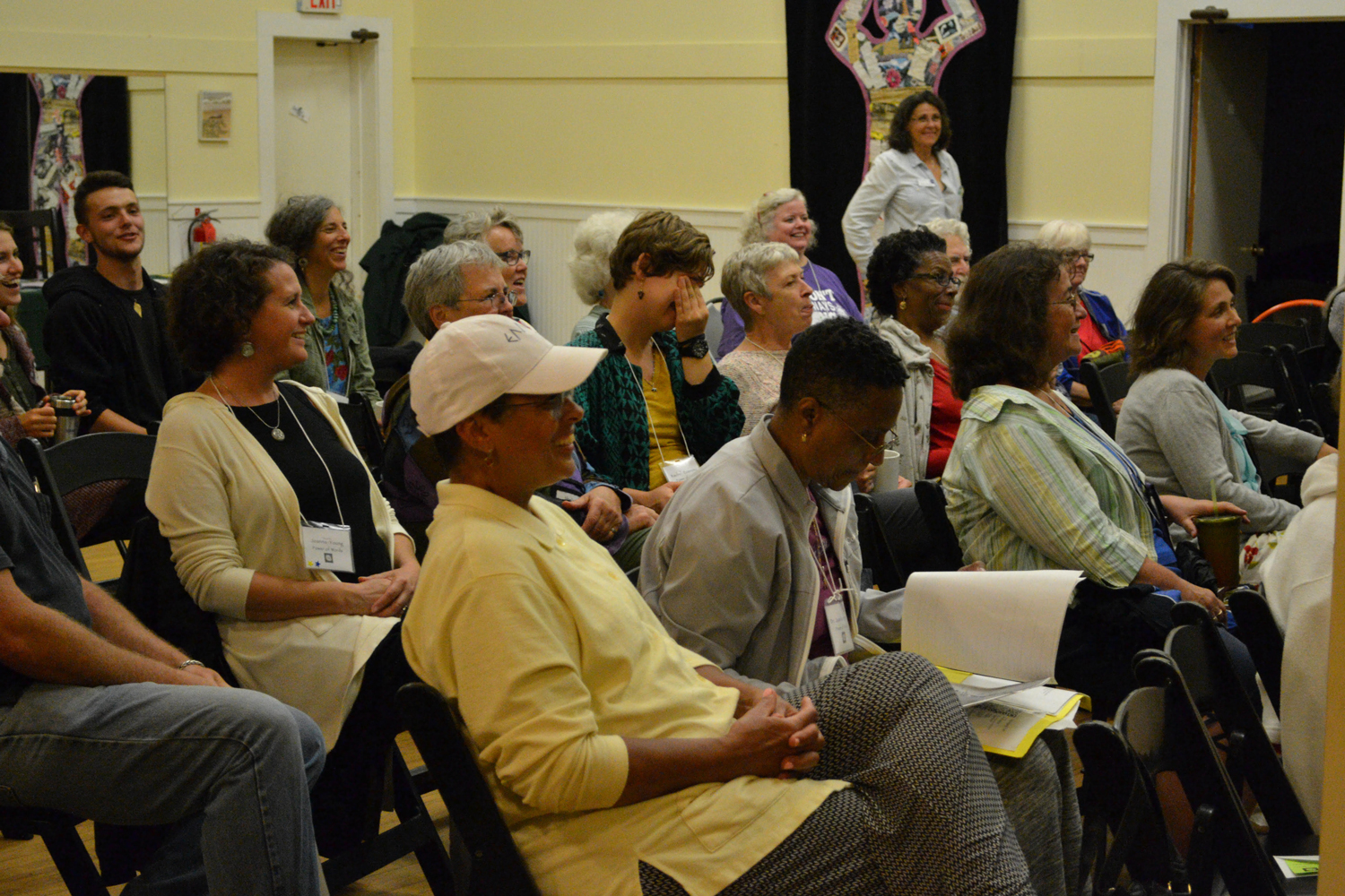 Attendees listen attentively to a presentation at a previous in-person Power of Words Conference.